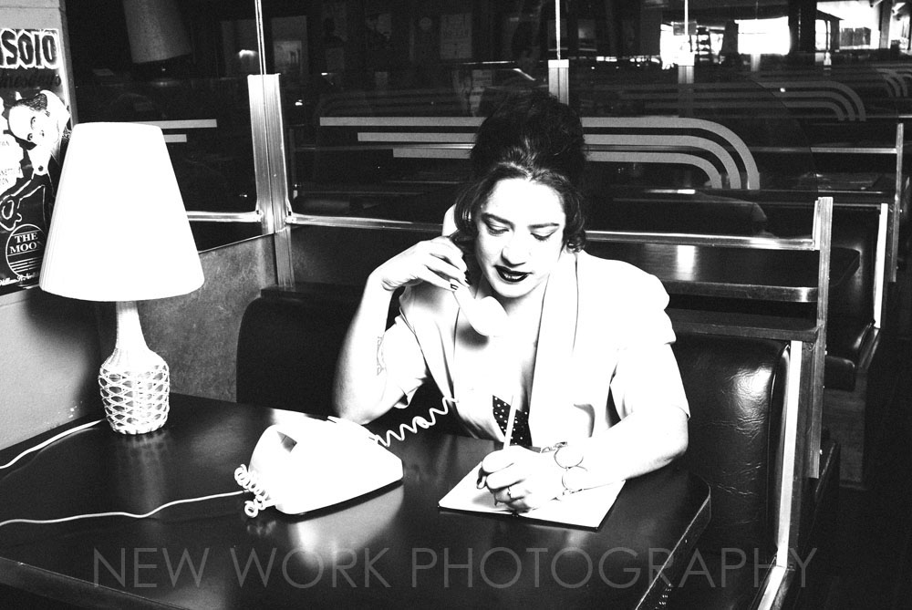 Black and white photo of woman on phone
